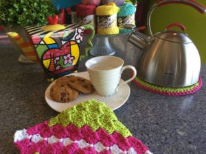 The Corner to Corner Dishcloth and Hot Plate Protector are both made with Bernat Handicrafter.