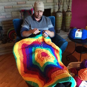 Mikey making the prototype of the Fluffy Unicorn Afghan to figure out yarn quantities.