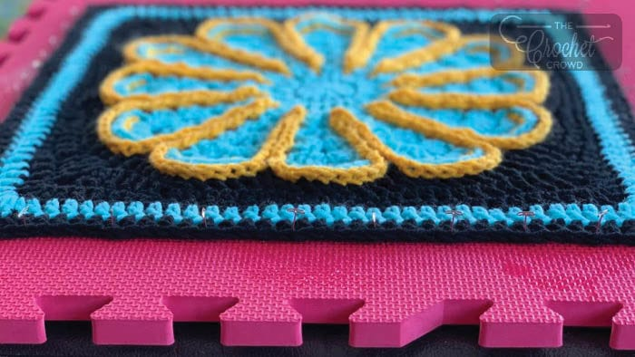 Pinned Blocking to Mat by Lauren Wolf