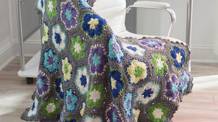 Crochet and Knit Home Sweet Home Patterns, pattern shown is the Flowers in Bloom Throw