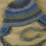 Collage Braided Ear Flap Crochet Hat
